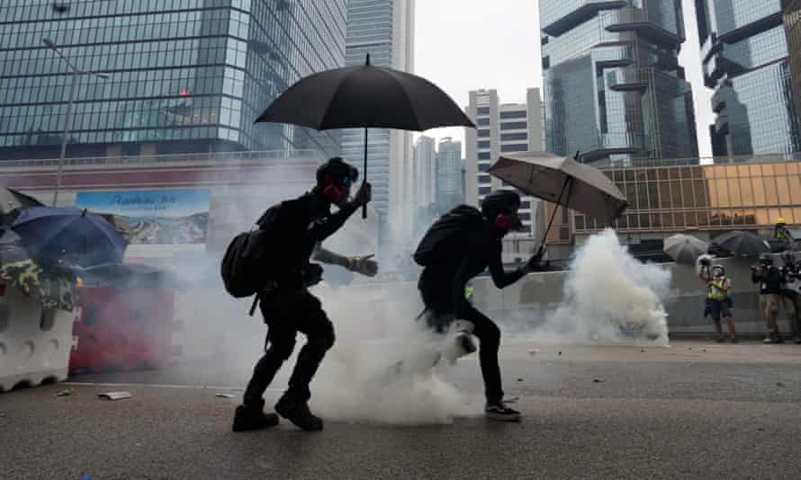 Protesters running for cover from teargas during the demonstrations yesterday.