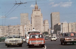 Framed by modern building of the Hotel Belgrade in downtown Moscow, the Soviet Foreign Ministry in its Stalinist style,
