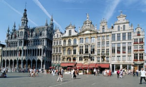 Wide shot of Grand Place,  on a bright sunny day. It is the central square in Brussels, Belgium.