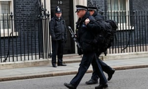 Armed police walk along Downing Street in London on 22 March following the Brussels attack.