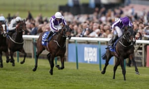 Ryan Moore riding US Navy Flag, right, wins the Darley Dewhurst Stakes at Newmarket from Mendelssohn.