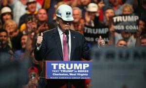 Donald Trump models a hard hat.