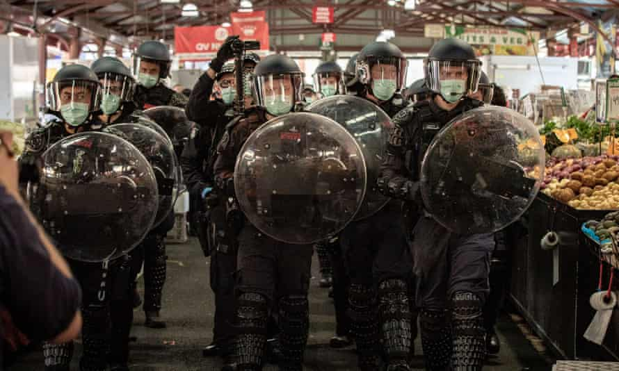 Police at the Queen Victoria Market amid anti-lockdown protests