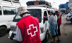 Health officials staff a checkpoint at the taxi-brousse station of Ampasapito district in Madagascar's capital, Antananarivo, to detect cases of plague.