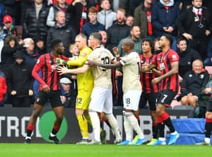 Bournemouth's Jefferson Lerma is held back by Aaron Ramsdale.