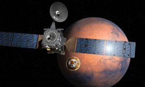 An artist's impression of the ExoMars space mission's Schiaparelli module separating from the Trace Gas Orbiter. The mission will search for life on the red planet.