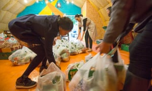 Former Kids Company staff and ex-clients pack bags at the Arches food bank at Loughborough Junction.