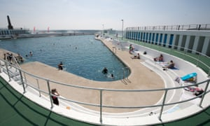Bathers at the recently reopened art deco Jubilee Pool lido in Penzance, Cornwall, UK