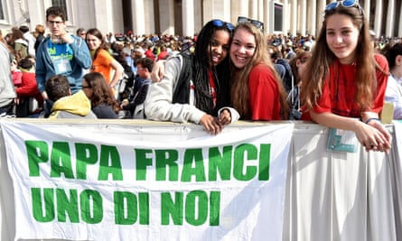 Young pilgrims with a banner that says 'Pope Francis one of us' as they attend mass during the Vatican's celebration of young people.