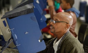 Voters cast their ballot during early voting at a polling station in Chicago.