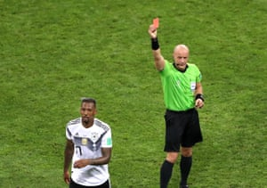 Jerome Boateng is shown a red card.
