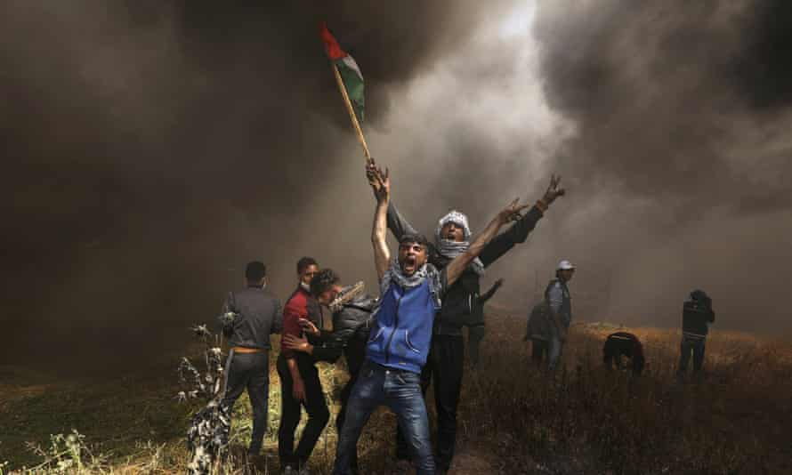 Palestinian demonstrators shout during clashes with Israeli troops at a protest at the Israel-Gaza border east of Gaza City, April 6, 2018