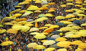 Pro-democracy protesters holding yellow umbrellas outside the government headquarters in Hong Kong in 2015.