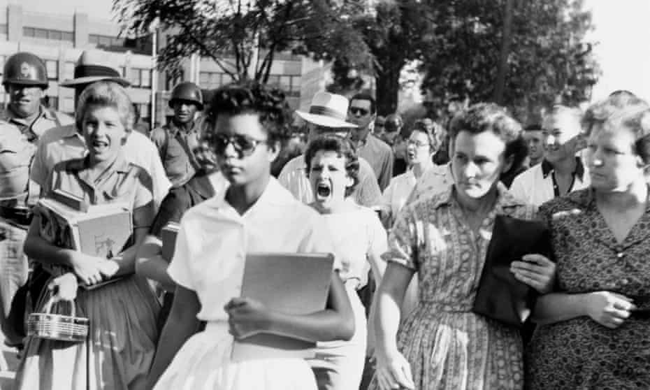 Elizabeth Eckford ignores the hostile screams and stares of fellow students on her first day of school.