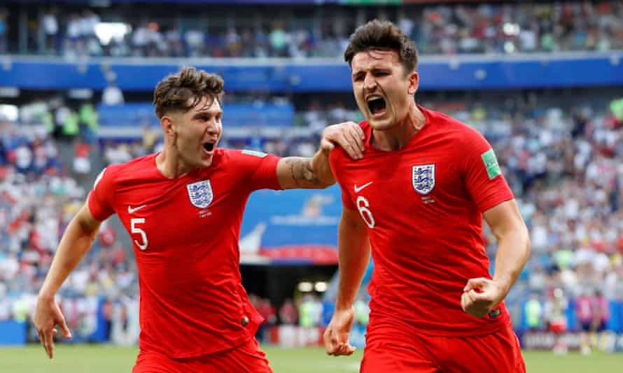 Harry Maguire celebrates with John Stones after scoring for England in the World Cup quarter-finals in 2018.