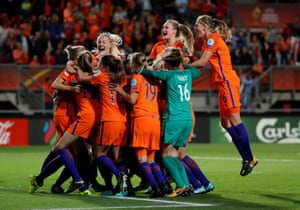 The Dutch players celebrate after the third goal.