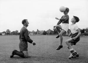 Docherty trains in the park with his 11-year-old son, Michael and a school friend in Ewell, Surrey in 1962.