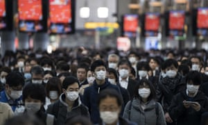 Commuters set off for work in Tokyo on March 26