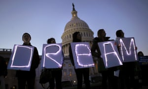 Demonstrators rallying for Daca hold a candelight vigil outside the Capitol on 18 January.