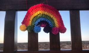 A crocheted knitted rainbow of hope, on a park bench in Joppa, Edinburgh during Covid-19 lockdown.
