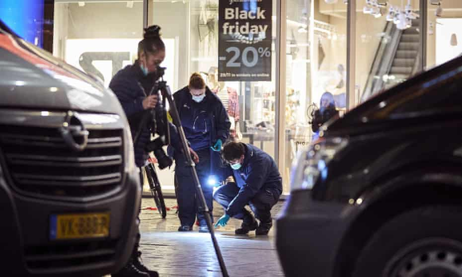 Forensic experts scan the area for evidence.