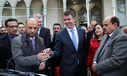 Mike Baird (centre) addresses thousands of Muslims surrounding the mosque in the Sydney suburb of Lakemba to mark the end of the holy month of Ramadan last year.