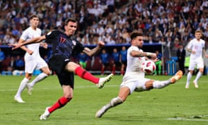 Mario Mandzukic of Croatia takes a shot as Kyle Walker of England attempts to block.