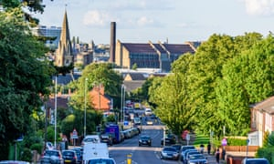Cityscape View of Northampton UK with road in foreground.