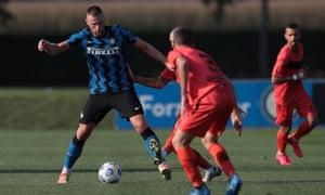 Milan Skriniar(left) in action for Inter against Lugano in a pre-season friendly on 15 September.