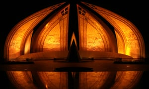 The national monument of Pakistan in Islamabad bathed in orange light