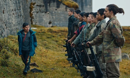 The Messenger (Wilson Salazar, left) puts the young soldiers through their paces in Monos.