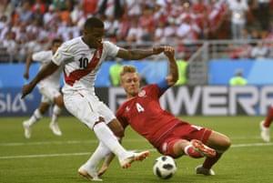 Jefferson Farfanis challenged by Denmark's Simon Kjaer.