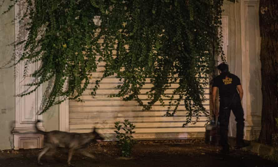 A Turkish police K9 unit searches the back garden of the Saudi Arabian consulate general residence on 17 October.