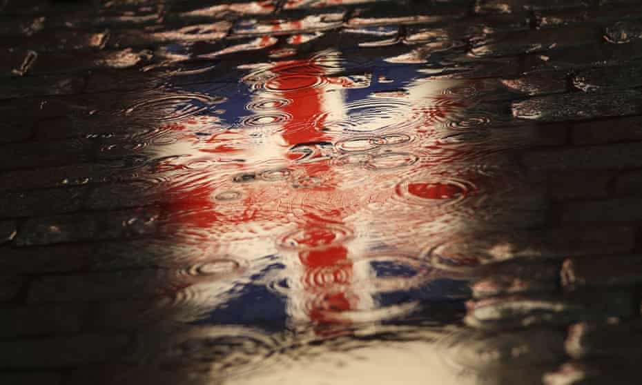 Reflection of union jack flag in puddle