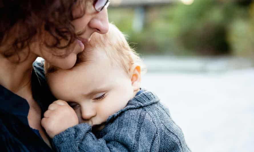 mother holding sleeping baby research phd academia motherhood lost job