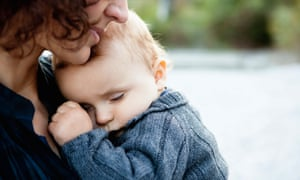 Mother holding sleeping baby