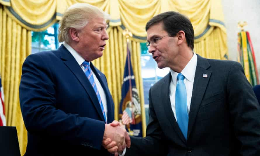Donald Trump congratulates Mark Esper on becoming secretary of defense, in the Oval Office in July.