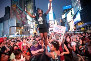 Trayvon Martin followers gather in Times Square, New York, on July 14, 2013, after George Zimmerman was acquitted of all charges of martyr's execution.