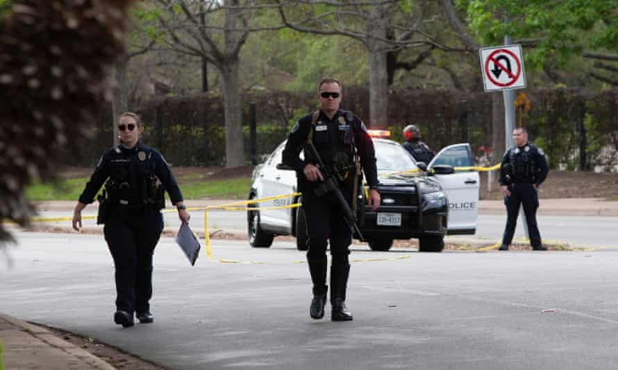 Austin police officers investigate at the scene of a deadly shooting at an apartment complex in Austin, Texas, on Sunday.
