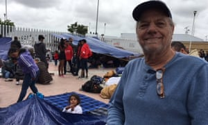 Dennis Tomlinson, a US tourist, at the makeshift migrant camp in Tijuana, Mexico.