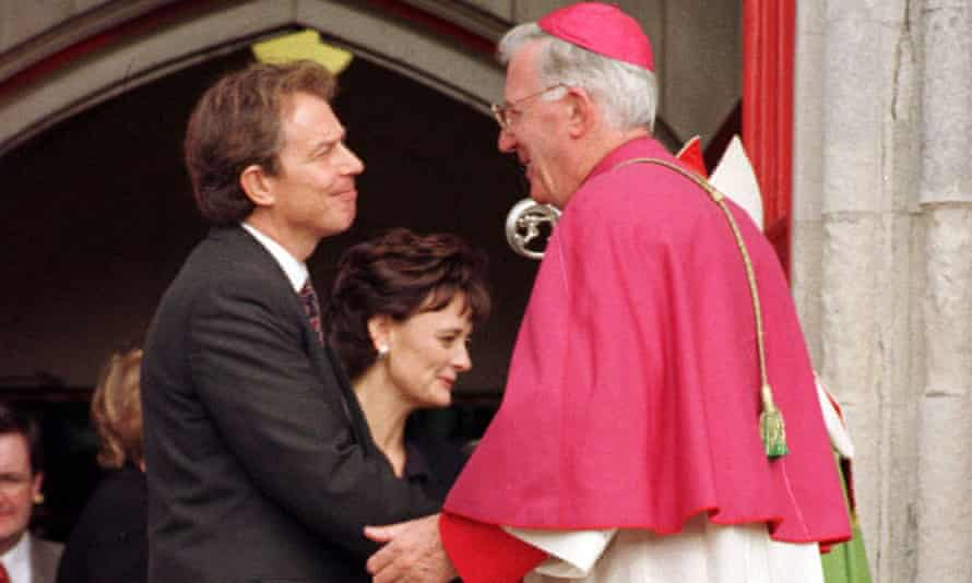 Cormac Murphy O'Connor with Tony and Cherie Blair in 1997; he guided the prime minister towards Catholicism.