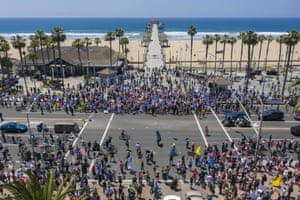 A crowd of protesters calling to reopen businesses and beaches in Huntington Beach, California.