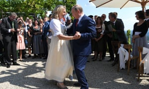 Austrian foreign minister Karin Kneissl and Russian president Vladimir Putin dance