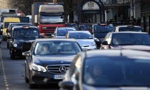 Vehicles pass along Marylebone Road in London.