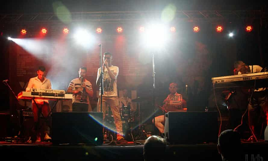 Band performing on a neon-lit smoky-looking stage at Nišville Jazz Festival, Niš, Serbia.