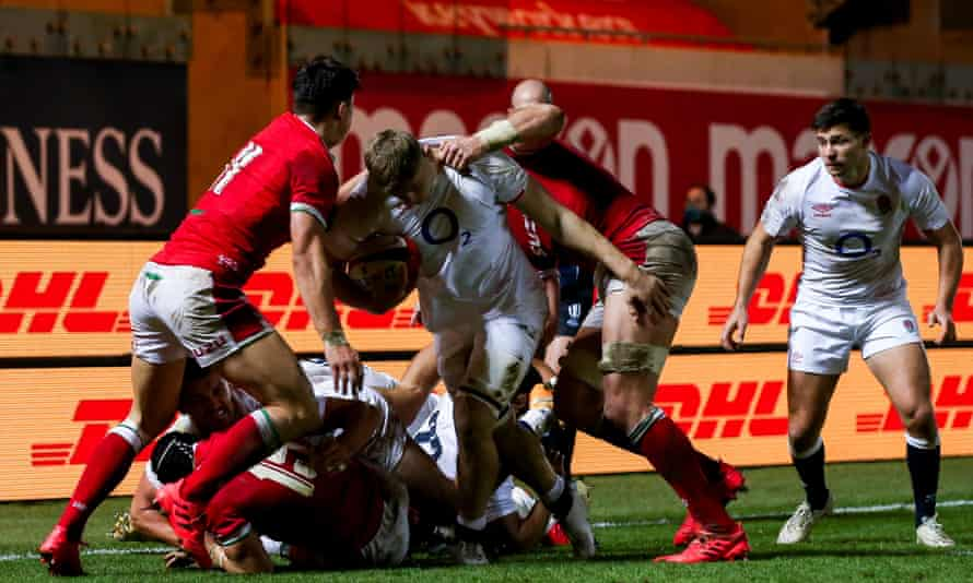 England's Jack Willis powers through a tackle in a physical encounter in Llanelli.