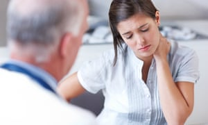 Woman looking down while doctor talks to her.