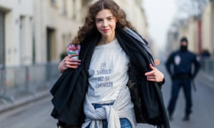 A model wearing a white T-shirt with the print 'We should all be feminists'.
