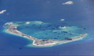 An image from United States Navy video shows Chinese dredging vessels in the waters in the disputed Spratly Islands in the South China Sea.