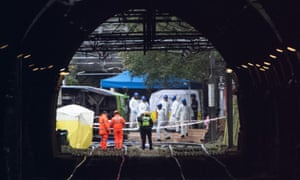 Workers at the scene of the tram crash